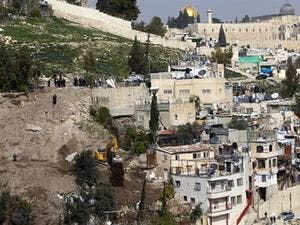 In this file photo, an Israeli army bulldozer destroys Palestinian houses in the East Jerusalem area of Silwan. (AFP/File)