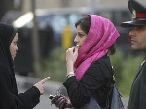 Iran argues that its ban on women attending sporting events in the same stadiums as men is necessary to protect them from rude language that might emanate from the stands. One would wonder why they don't ban the men instead?   (AFP/File)