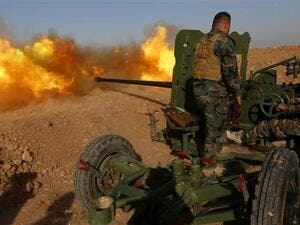 Iraqi Kurdish Peshmerga fighters fire an anti-tank cannon on the front line near Hasan Sham village, some 45 kilometers (27 miles) east of Mosul, during an operation aimed at retaking areas from Daesh on May 29, 2016. (AFP/File)