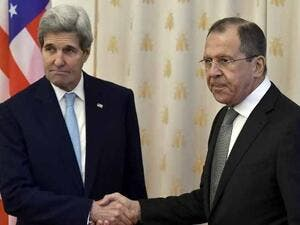 Russian Foreign Minister Sergei Lavrov shakes hands with US Secretary of State John Kerry during their meeting in Moscow on December 15, 2015. (AFP/File)