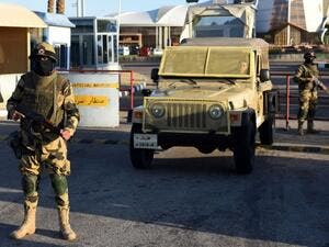 Egyptian army special forces man a temporary checkpoint outside Sharm el-Sheikh airport. (AFP/File)