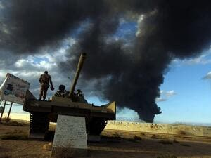 A member of the Libyan army stands on a tank. (AFP/File)