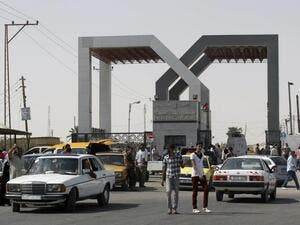 Vehicles drive through the Rafah border crossing point in the southern Gaza Strip on 19 September 2013. (AFP/File)