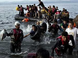 Refugees disembark from lethal dinghy boats after crossing. (AFP/File)
