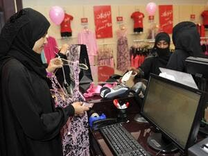 Fully-veiled Saudi women shop at a lingerie store in the Saudi Red Sea port of Jeddah on 2 January 2012. (AFP/File)