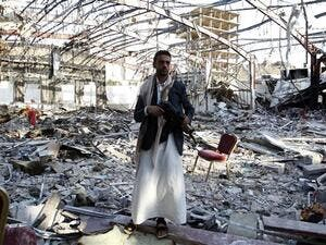 A Yemeni man stands on October 24, 2016 at the site of a Saudi airstrike on a funeral ceremony that killed 140 people and wounded 525 others earlier this month. (AFP/File)