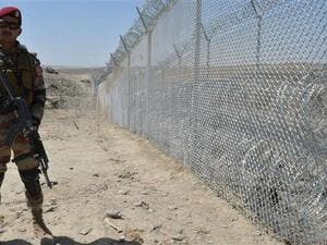 A Pakistani army soldier stands guard along the fence at the Pak-Afghan border near the Punjpai area of Quetta in Balochistan. (AFP)