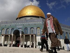 A Palestinian man walks past Al-Aqsa Mosque compound before the Friday prayer in Jerusalem's Old City on January 13, 2017. (AFP/Ahmad Gharabli)