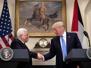 US President Donald Trump and Palestinian President Mahmoud Abbas shake hands at the White House, in Washington DC, May 3 2017. (AFP/Nicholas Kamm)