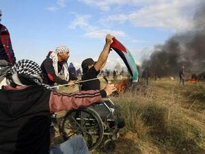 Ibrahim Abu Thuraya protesting shortly before his death on Dec. 15 in Gaza (Mohammed Abed/AFP)