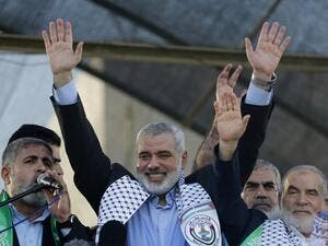This file photo taken on August 27, 2014 shows Hamas leader in the Gaza Strip Ismail Haniya (C) waving to the crowd during a rally in Gaza City following a deal hailed by Israel and the Islamist movement as 'victory' in the 50-day war. (AFP/Mohammed Abed)