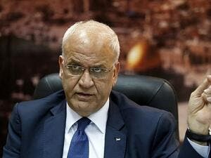 PLO Secretary General Saeb Erekat in his Ramallah office. (AFP/Abbas Momani)