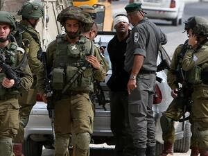 Israeli forces arrest a Palestinian in occupied West Bank. (AFP/ File Photo)
