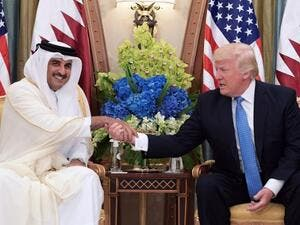 This file photo taken on May 21, 2017 shows US President Donald Trump (R) speaks with Qatar's Emir Sheikh Tamim Bin Hamad Al-Thani, during a bilateral meeting at a hotel in the Saudi capital Riyadh.