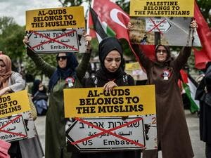 "Women protestors hold placards reading ""Al Quds belongs to the Muslims"" /AFP"