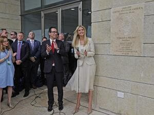 US Treasury Secretary Steve Mnuchin (L) and US President's daughter Ivanka Trump stand next to an inauguration plaque during the opening of the US embassy in Jerusalem on May 14, 2018/AFP