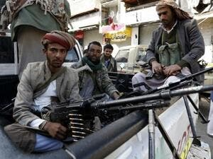 Houthi rebels in front of the residence of former president Ali Abdullah Saleh in Sanaa. (AFP/ Saleh AL Obeidi)
