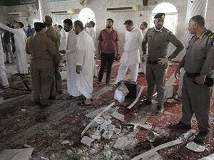 Saudi policemen gather around debris following a blast inside a mosque in Qatif. (AFP/File)
