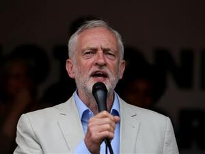 UK opposition Labour party leader Jeremy Corbyn speaks to protesters in Parliament square during an anti-austerity demonstration on July 1, 2017 in London. (Photo by AFP)