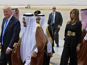 US President Donald Trump (L) is welcomed by Saudi King Salman bin Abdulaziz al-Saud (2nd-L) upon arrival at King Khalid International Airport in Riyadh on May 20, 2017, followed by First Lady Melania Trump (R). (AFP/Mandel Ngan)