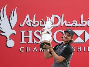 Tommy Fleetwood of England poses with the winner's trophy during the final day of the Abu Dhabi Golf Championship in the capital of the United Arab Emirates on January 22, 2017.