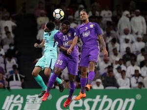 Al-Ain's forward Ahmed Khalil (C) and midfielder Caio (R) vie for the header with Al-Hilal's defender Mohammed Al-Breik during the AFC Champions League football match between UAE's al-Ain and Saudi's al-Hilal at the Hazza bin Zayed Stadium in Al-Ain, on April 2, 2018.