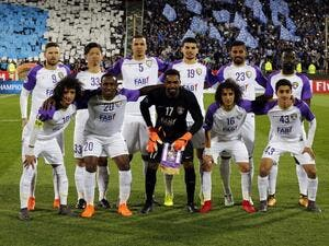 Al-Ain's starting eleven pose for a group picture ahead of the AFC Asian Champions League group D football match on March 12, 2018, at the Azadi Stadium in Tehran.
