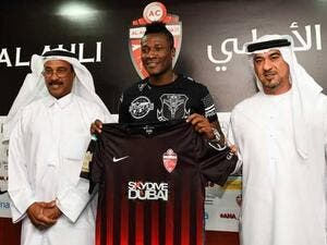 Asamoah Gyan, new signing of Al Ahli club with CEO Obaid Saeed and team manager Abdul Majid Hussain at a media conference in Dubai (Photo: Gulf News)
