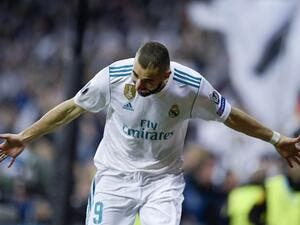 Real Madrid's French forward Karim Benzema celebrates after scoring a second goal during the UEFA Champions League semi-final second leg football match between Real Madrid and Bayern Munich at the Santiago Bernabeu Stadium in Madrid on May 1, 2018.