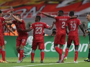 Al-Duhail SC's players celebrate their victory against Persepolis FC during their AFC Champions League football match at Khalifa International Stadium in Doha on August 28, 2018.