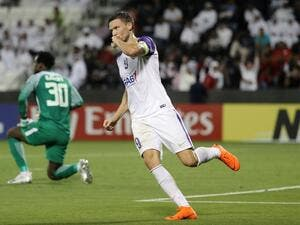 Al Ain FC's Swedish forward and captain Marcus Berg celebrates after scoring a goal against Al-Rayyan SC during their Asian Champions League football match at Jassim Bin Hamad Stadium in Doha on April 16, 2018.