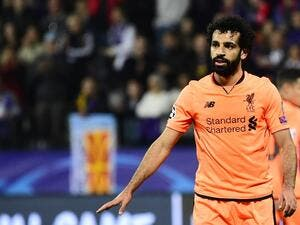 Liverpool's red-hot winger Mohamed Salah went three goals clear on top of the Premier League scoring charts after netting against Arsenal again in an exhilarating 3-3 draw on Friday.
