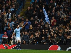 Manchester City's Algerian midfielder Riyad Mahrez celebrates after scoring their fifth goal during a UEFA Champions League group F football match between Manchester City and Shakhtar Donetsk at the Etihad stadium in Manchester, northwest England on November 7, 2018.