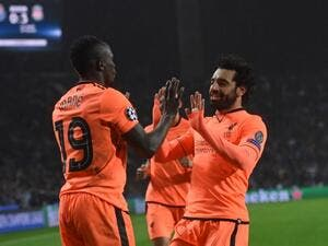 Liverpool's Senegalese midfielder Sadio Mane (L) celebrates with Liverpool's Egyptian midfielder Mohamed Salah after scoring their third goal during the UEFA Champions League round of sixteen first leg football match between FC Porto and Liverpool at the Dragao stadium in Porto, Portugal on February 14, 2018. Liverpool won the game 5-0.