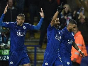 Leicester City's Algerian striker Islam Slimani (L) reacts after Leicester City's Algerian midfielder Riyad Mahrez (C) scored his team's first goal during the UEFA Champions League group G football match between Leicester City and FC Copenhagen at the King Power Stadium in Leicester, central England on October 18, 2016.