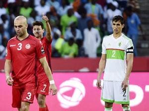 Tunisia's midfielder Youssef Msakni (L) gives a thumbs-up next to Algeria's defender Aissa Mandi at the end of the 2017 Africa Cup of Nations group B football match between Algeria and Tunisia in Franceville on January 19, 2017.