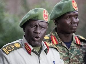 Former Sudan People's Liberation Army (SPLA) chief of general training and former in-opposition general Dau Athorjang (L) speaks during a press conference, pledging his allegiance to the SPLA on July 10, 2016 in Juba. (AFP/Charles Atiki Lomodong)