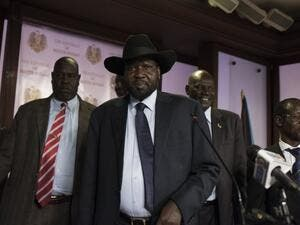 South Sudan President Salva Kiir (C), followed by Vice President James Wani Igga (2nd R), leaves the conference room as artillery fire broke out near the presidential palace in Juba on July 8, 2016. (AFP/Charles Atiki Lomodong)