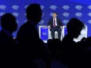 China's President Xi Jinping delivered a speech during the first day of the World Economic Forum, on January 17, 2017 in Davos.  (AFP/Fabrice Coffrini)