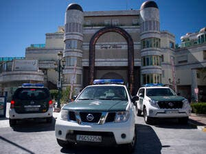Spanish police vehicles outside one of the properties seized from the uncle of Syrian President Bashar al-Assad.