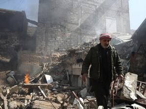 A Syrian man inspects the damage following reported government airstrike on the rebel-held town of Douma, on the eastern outskirts of the capital Damascus, on February 26, 2017. (AFP/Abd Doumany)
