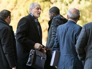 Syria's United Nations ambassador and head of the government delegation Bashar al-Ja'afari (2nd L) leaves after a meeting with UN Special Envoy for Syria Staffan de Mistura during the first day of a new round of Syria peace talks in Geneva, Switzerland, on February 23, 2017. (AFP/File)