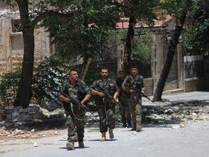 Syrian army soldiers patrol a damaged area of west Aleppo (AFP/File)