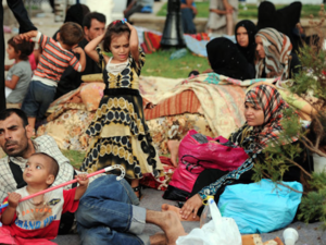 Syrian refugees wait in Port Said Square in Algiers, Algeria. (AFP/File)