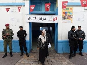 A Tunisian woman exits a Tunis polling station after voting in the first round of presidential elections on November 23, 2014. (AFP/File)