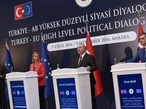 EU Enlargement Commissioner Johannes Hahn, European Union's Foreign Policy Chief Federica Mogherini, Turkey's Foreign Minister Mevlut Cavusoglu, and Turkey's EU Minister Omer Celik take part in a press conference on September 9, 2016 in Ankara. (AFP/Adem Altan)