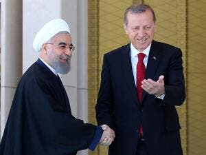 Turkish President Recep Tayyip Erdogan (R) shakes hands with his Iranian counterpart Hassan Rouhani. (AFP/ File)