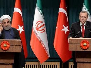 Turkish President Recep Tayyip Erdogan (R) speaks during a joint press conference with his Iranian counterpart Hassan Rouhani in Ankara. (AFP/ File)