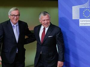 President of the European Commission Jean Claude Juncker (L) welcomes Jordanian King Abdullah II (R) at the European Commission headquarters in Brussels, ahead of a meeting on December 12, 2018. (AFP)