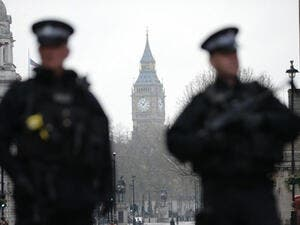 Armed police secure the area around the Houses of Parliament (AFP)